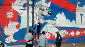 Artistas ilustram muro da Vila Esperança para a Copa do Mundo 2018